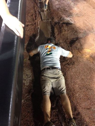 Head Groundskeeper Marty Wallace clears a drain Thursday night. Picture taken by season ticket holder Leigh Ann Browning.