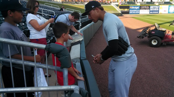 Taijuan Walker signs autographs for fans in Birmingham.