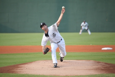 Reliever Kyle Hunter delivers a pitch on Saturday night.