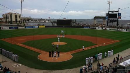 Fans stand for the National Anthem before yesterday's July 4th game in Pensacola.