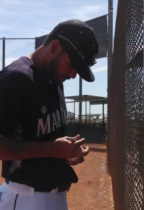 Stefen Romero signing autographs after batting practice Sunday.